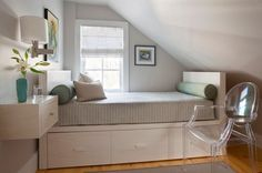 small bedroom with storage under bed