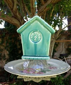 """New """" Turquoise House"""",   Bird Feeder, sits on clear small clear glass bowl, then on beautiful vintage china plate with colorful Flowers.. on the bottom is another small glass plate. Hangs on strong wire with lots of matching beads & charms.   Organic bird seed & gift card   included with all feeders.   $43 + shipping   This feeder has four layers of glass, china & ceramic pieces."""