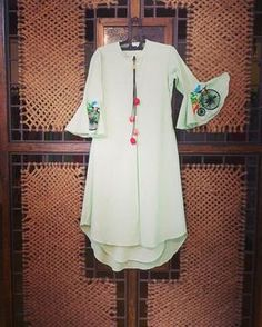 Bright floor length dress in cotton with hand embroidered cycle motif and tassle detailing in front. This breezy outfit is the perfect example of casual chique. Kurti Patterns, Dress Patterns, Kurta Designs Women, Blouse Designs, Salwar Designs, Indian Attire, Indian Wear, Indian Dresses, Indian Outfits