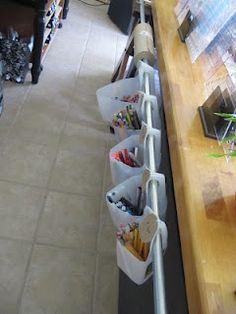 Wow. empty milk jugs and electrical conduit make a great spot for storing small items! organizing