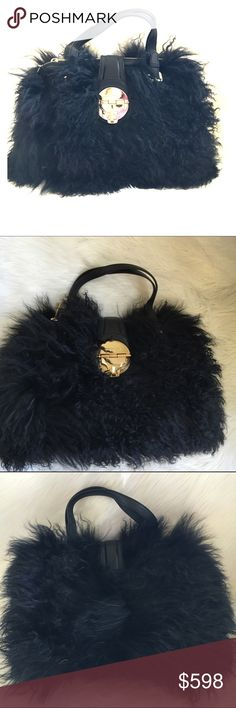 Michael Kors Genuine Fur And leather satchel Mongolian Lamb leather and fur satchel with gold tone hardware. trades Authentic Michael Kors Bags Satchels