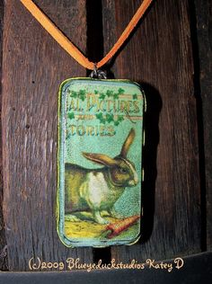 """Wow - what a finish to this """"domino"""" style pendant. This is TRULY ONE OF A KIND. I dare you to find one like it ♥ Holiday Sale Garden Hare Rabbit Organic by blueyeduckstudios, $12.00"""