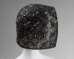 Halston | Hat | American | The Met mid-1960s synthetic netting, plastic Dimensions: Length (CF to CB): 16 1/2 in. (41.9 cm) Fascinator Hats, Fascinators, Headpieces, Maker Culture, Costume Institute, 1960s Fashion, Art Object, Black Metal, Enamel