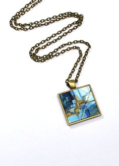 This is a one of a kind wearable art piece by Dana Marie.  Holiday Sale: Originally $35 FREE Shipping for Buyers within the United States.  Each piece is an original miniature painting.    City Bay  Original Acrylic Painting Size: 1 inch X 1 inch  Pendant: Antique Bronze Tone Bezel  Pendant Size: approx 1 (25mm) (not including the bail)  Necklace: 24 Rolo Chain Necklace (Antique Bronze Tone) w/ a Lobster Clasp Note: Your wearable art piece is not waterproof and should not be worn while…