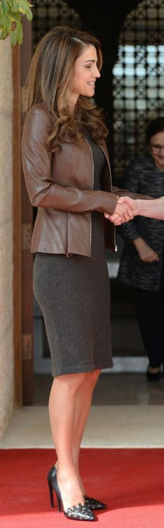 Queen Rania of Jordan in a gray sheath and chocolate leather jacket.