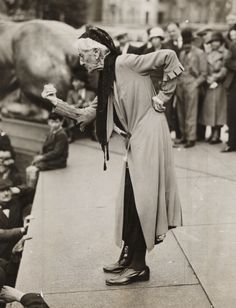 Charlotte Despard (1844-1939), speaking at an anti-fascist rally in Trafalgar Square, London, taken in June 1933 by James Jarché.  Despard was a suffragist, novelist (Chaste as Ice and Pure as Snow were two) and Sinn Féin activist. She devoted a lot of her time and money to helping the poor in Battersea. She lived above one of her welfare shops in one of poorest areas of Nine Elms. Very sturdy shoes.