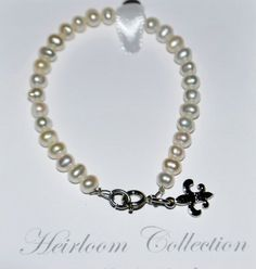 "$19.99 DR - 5"" Girls Fleur De Lis Bracelet with Freshwater Pearls & Silver, Perfect for Christmas Stocking Stuffer, Church, First Communion, Easter, Graduation, Sunday Dress, Christening or Birthday. Value Line, http://www.amazon.com/dp/B005HFBJA8/ref=cm_sw_r_pi_dp_jDkYqb0S8H8HP"