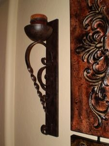 Set/2 Tuscan Twisted Wrought Iron Candle Sconces - Accent a large piece of artwork or a mirror by putting one on each side.  Found at http://www.tuscanhomedecorandmore.com/servlet/the-296/Twisted-Iron-candle-sconces%2C/Detail#