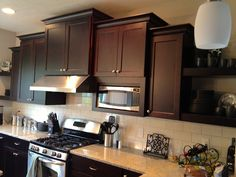 Dark cabinets, light granite, subway back splash. Also I like how the vent is framed.