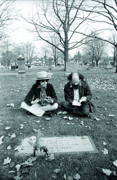 Dylan and beat poet Allen Ginsberg sitting at Jack Kerouac's grave during the Rolling Thunder tour, Lowell MA