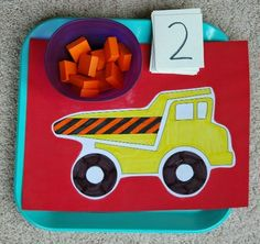 "Simple math game to use with preschoolers during construction theme.  Have child add the correct number of ""rocks"" to the back of the dump truck.  Can also use simple addition problems for older hcildren."