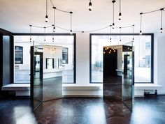 Wülser Bechtel Architekten has completed a barbers in Zurich with a pair of sculptural mirrors and a floor that reveals traces of the building's history In Dubai, Retail Interior, Interior And Exterior, Interior Design, Beauty Salon Interior, Ceramic Floor Tiles, Shop Interiors, Dezeen, Zurich