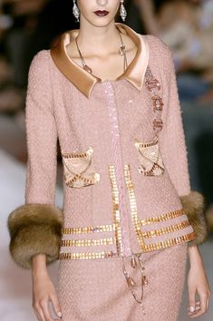 Christian Lacroix Fall 2005: The wide collar adds weight, thus creates a fuller shoulder line and with all the detail around the waist, hip and wrist area - the monotone line of the rectangle shape appears to be more curvacious