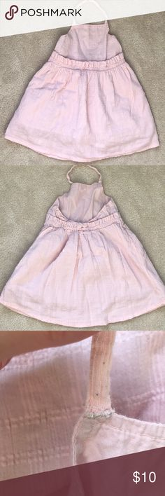 Baby Pink Halter Dress This is the sweetest little dress. It is the perfect baby pink for your little girly girl. 100% Cotton. I will say it is GUC- this is *only* because the strap broke and I had to sew it, but it is not noticeable from the outside, you can only see in the inside. It is actually more secure now than it was before. Otherwise, it is in EUC with no holes or stains. Halter secures with one button. It's super lightweight, gauze-y, comfortable material. Perfect for summer or…