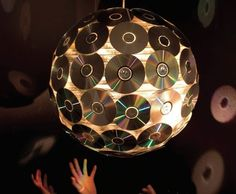9. Up-cycle some old CD's to create a disco ball. | 11 Clever & (sometimes) Useful Office DIYs! Brought to you by Shoplet.com - everything for your business.