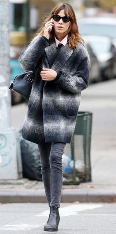 Alexa Chung cozied up to a two-toned cocoon coat that she shrugged on over a sweater, pink button-down, gray skinnies, and ankle boots.