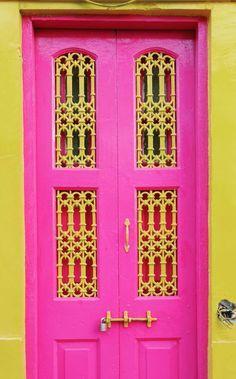 Bright pink door in Karachi, Pakistan.