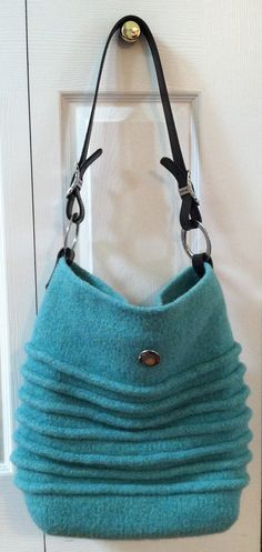 My knitted and felted bag from pattern: Noni Bedouin Bag. My lining with interior pockets & 2-way zipper. Handles & hardware by Homestead Heirlooms. Wool yarn by Stonehedge Fiber Mill. Vintage button.