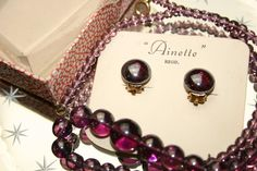 Vintage Glass Beads Necklace & Earrings in Box, £7.50 by Gillard and May - A purple coloured glass beads necklace and matching pair of clip on earrings in their original box. Made by Ainette.  The necklace has a roll clasp and measures approximately 42cm (16.5ins) long.