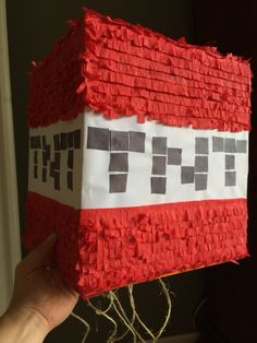 This is the pull string Minecraft piñata I made for 88 cents! Large box, crape and construction paper and glue! It took 3 hours with time to rest/dry!