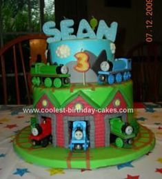 Homemade Thomas And Friends Birthday Cake: I made this Thomas And Friends Birthday Cake for my son's 3rd birthday. The cake was iced in the blue and green buttercream first. The bottom is 3 layers