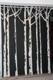 Graphic birch tree forest mural in Los Angeles loft by artist Allison Cosmos