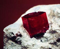 Red Beryl on Rhyolite Matrix.