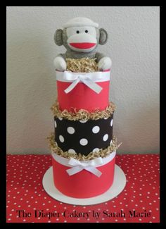 Sock Monkey Diaper Cake! #sock monkey #diaper cake #baby shower #diapers #3 tier # red #brown #diapers #centerpiece #baby gift