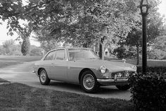 MGB GT. Available as a 4 cyl 1.8, or a V8 3.5 which was awesome to drive. The 3.5, originally designed and manufactured in the good old US of A was a fantastic engine and powered countless models of British Cars. It actually weighed less than the 1.8 engine !