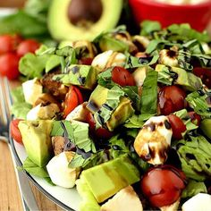 Avocado and Chicken Caprese Salad  _ Romaine lettuce Cherry tomatoes, halved Avocado, chopped Fresh mozzarella, chopped cooked chicken breasts, chopped (I used garlic salt & pepper-seasoned, sauteed chicken breasts) Fresh basil, torn balsamic reduction. Top plates of lettuce with tomatoes, avocado, fresh mozzarella cheese, chicken, and basil. Drizzle balsamic reduction on top then serve.