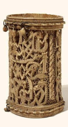 Nigeria | Double armlet; carved from a single block of ivory, outer carved layer [.1] and inner layer [.2] perforated with decoration. The two layers move independently of each other, but cannot slip apart. Carved with human and animal figures. Jingles formerly attached to loops at top and bottom of armlet are mostly now missing. | Yoruba people | Ijebu (Benin); collected in 1897.