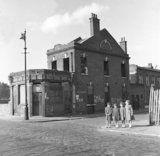 Four girls standing on street corner.