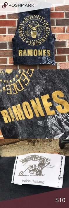 NWOT Ramones band muscle tank New without tags! Ramones muscle tank. Very cool distressed design with gold lettering! Perfect look for the rocker style 🤘🏻 Deep arm holes allow it to be paired with a cute bandeau! UNISEX style. No size specified, but fits like a M/L (for women's comparison). Tops Tank Tops