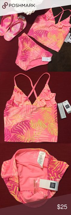 Gap Girls Tank Swim Bundle product details: Tank strap top. Ruffled neckline. Bikini bottom. Allover palm leaf print. Fully lined. UPF 40+ protects skin from the sun.   fabric & care: 82% Poly, 18% Spandex. Machine wash. Imported. (Comes with matching flip flops sized 12/13) No trades. GAP Swim Bikinis