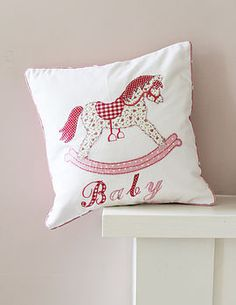 new baby girls rocking horse cushion by lime tree interiors | notonthehighstreet.com