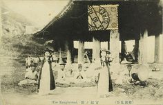 """The Korean kisaeng were professional girls trained in music, dance, and poetry. """"Official kisaeng"""" (관기 官妓), as depicted in this vintage postcard, were employed by the government and performed at ceremonial banquets. In the background, an ensemble playing traditional Korean instruments. The building in the background is Pubyok Pavilion by kernbeisser"""