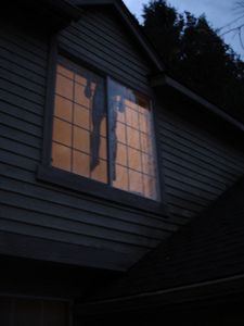 A life-size body hanging inside the window of your home - a great Halloween decoration! photo by Merelymel13 on Flickr