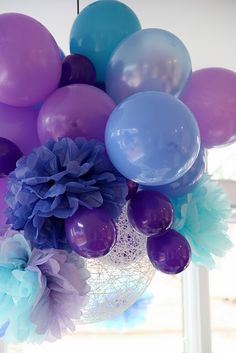 Inexpensive party decor: clusters of various colored and sized balloons with lanterns and tissue poms