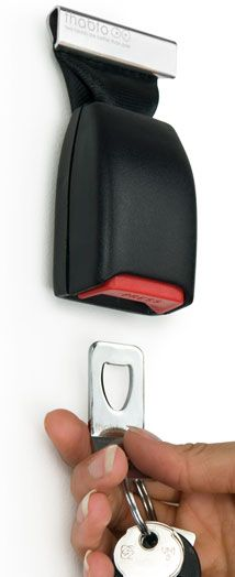 "Key chain/holder from old seatbelt buckles. Wicked. Keep those keys in a ""safe"" place..."