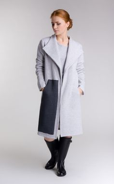 https://www.cityblis.com/5066/item/14595  Coat - $120 by SheMore  Cosy, simple cut coat made of thick cotton knitted fabric. Features a big asymmetrical front pocket and a shawl collar. Perfect grey shade to match everything for every day.  Fabric composition: 100% cotton Total length: 95 cm Chest: 53 cm Sleeve length: 63cm