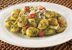 1/3 c Extra Virgin Olive Oil 1 pack Gnocchi 1 jar Artichoke Quarters, drained and chopped  1 jar Roasted Red Peppers*, drained and chopped 2 cloves garlic, finely chopped 1 jar Pesto Sauce 1/2 c Shredded Romano Cheese 1/2 c Heavy Cream Saute gnocchi in oil5min,put on paper towel, add all ingredients in pan, cook2-3min add back gnocchi and cheese.stir.