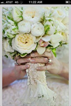 Mom's wedding dress sleeve around bouquet