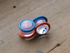 Portal Plugs 1/2 and larger by ghoag on Etsy, $12.00    They are so cool! She also has so other really cute plugs and fake plugs too! Plus she does custom orders as well!
