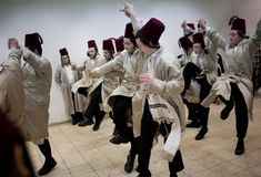 Utra Orthodox Jewish men celebrate Purim inside a synagogue in Jerusalem on March 9. The Jewish holiday of Purim celebrates the Jews' salvation from genocide in ancient Persia, as recounted in the Scroll of Esther. (Bernat Armangue/Associated Press) #