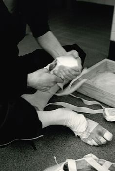 """Apollo, April 2003, The Royal Ballet, Covent Garden, London. Darcey says, """"Protecting my feet for the performance ahead. I individually bandaged each toe so that I didn't get too many blisters. I have always felt this must be similar to strapping a boxer's hands."""" Photograph : Bryan Adams"""