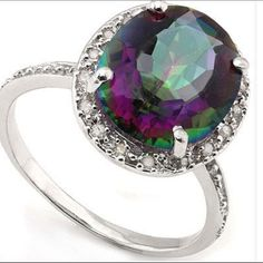 Mystic Gemstone and Diamond Ring Marvelous 4 2/5 Carat Mystic Gemstone and Diamond 925 Sterling Silver Ring.  Size 7 SRP $320. Item no. 8294-11-0194 Jewelry Rings