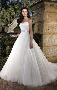 This princess wedding dress in Soft Organza over Dolce Satin features a sparkling Diamante-embellished sweetheart bodice that can be accentuated with an optional beaded satin belt. The full princess skirt is accented with hand-placed twinkling Swarovski Crystals and flows into a semi-cathedral train. Lace up or zipper back available.  Essense of Australia D1042