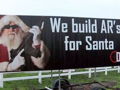A billboard shows Santa Claus holding an assault rifle