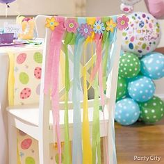 Add a sweet and sparkly touch to your seating with pastel streamers and glittery flowers taped to the back of each chair.