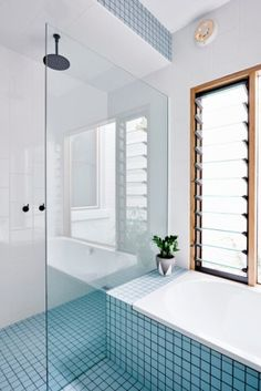 Neat grid tiles and simple, angular design bathroom